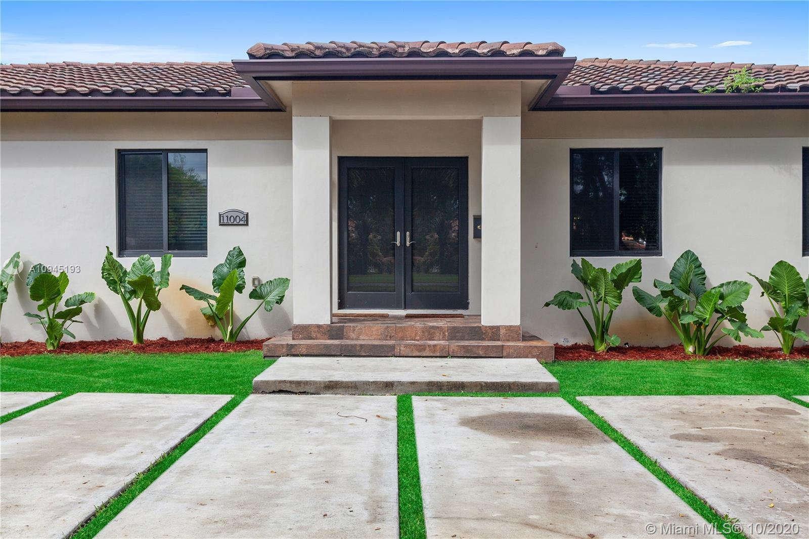 This new construction home is nestled on a double lot in the sought after Miami Shores neighborhood.