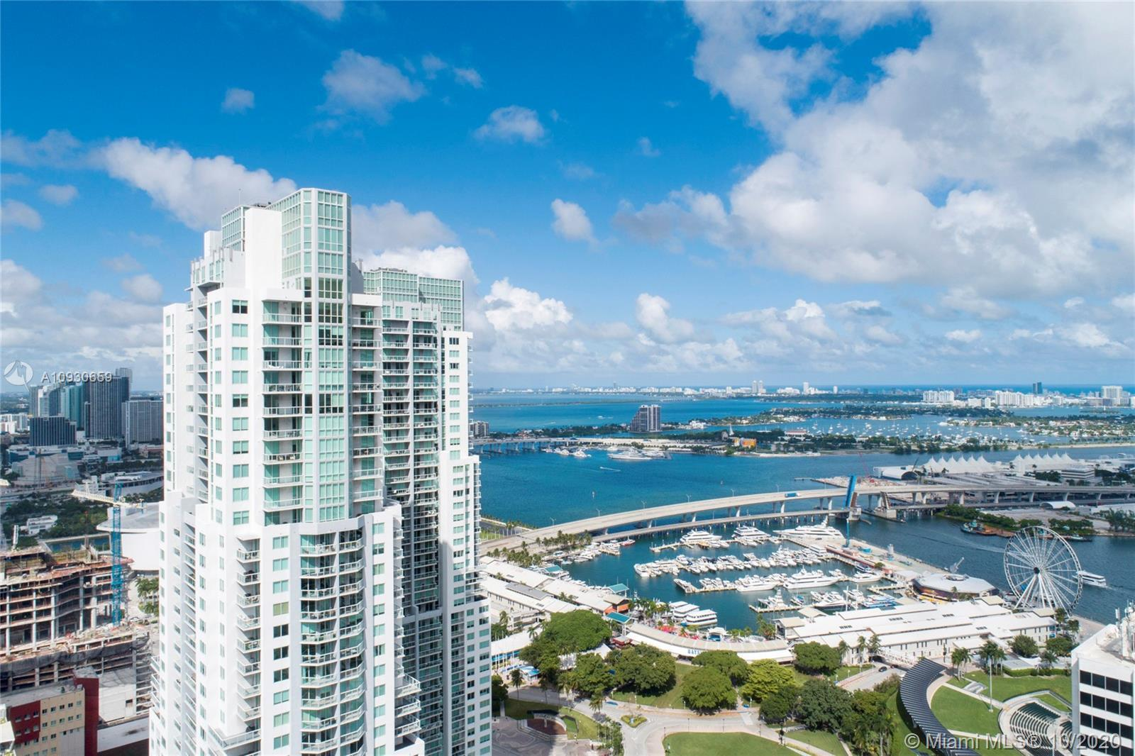 One-of-a-kind home in the Sky! Huge 2,500+ SF combined unit with 180-degree panoramic water and city