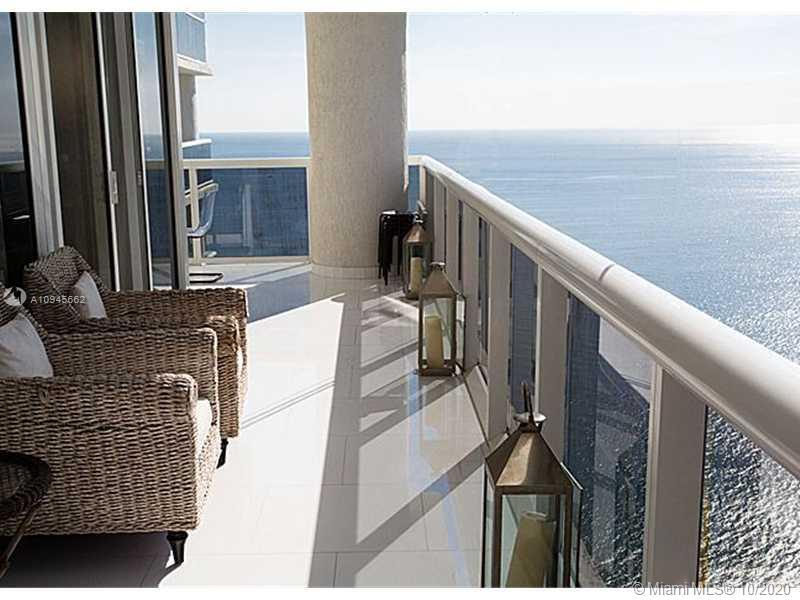 Penthouse corner unit with breathtaking views of the beach and the city. White floors throughout, up