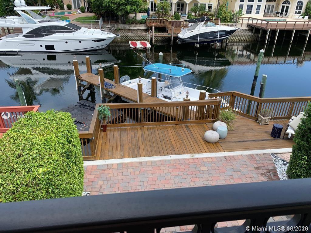 Prestigious Waterfront Home in Harbor Islands. 3 bedroom + 3 full bath. Large waterfront patio with