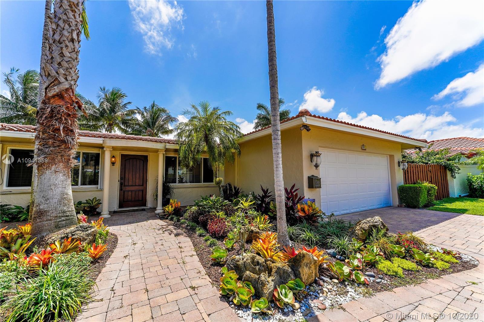 BEAUTIFUL AND UPGRADED 3BR/2BA HOME WITH A CIRCULAR DRIVEWAY, SALT WATER POOL AND 2 CAR GARAGE ON A