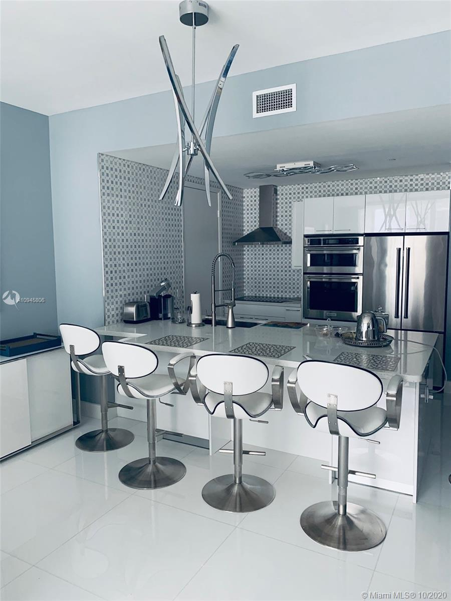 NICELY REMODELED, BRIGHT AND CLEAN UNIT AT TRUMP TOWER III, SUNNY ISLES BEACH. FULL SERVICE BUILDING