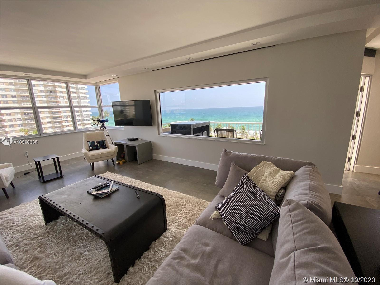 Imagine waking up in this corner apartment watching the waves crest the beach. Spectacularly renovat