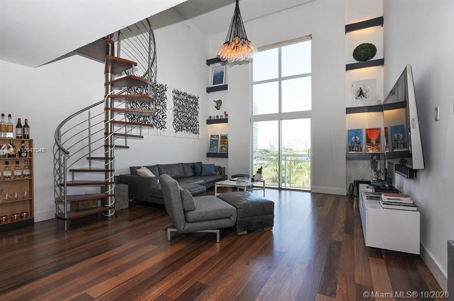 Rarely available Loft at Sunset Harbor. Soaring Ceilings. Bright and Spacious loft with 20ft ceiling