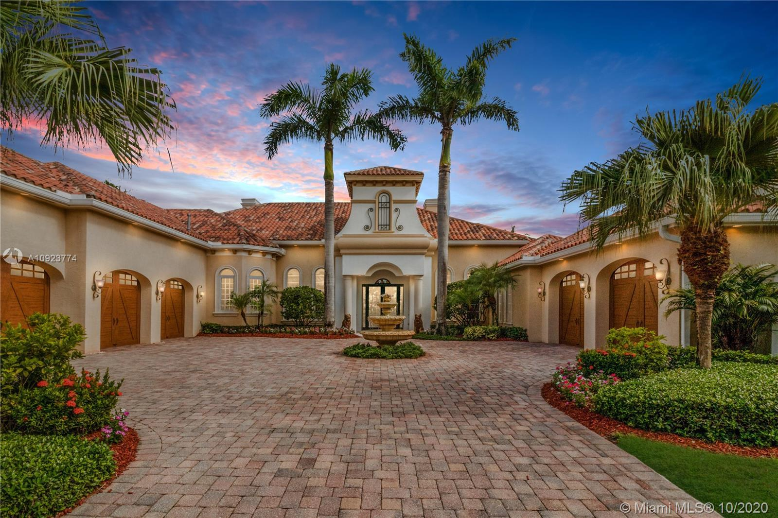 La Bahama Hacienda, one of 12 custom-built estates, is tucked away on The Island at Boca West, a pri