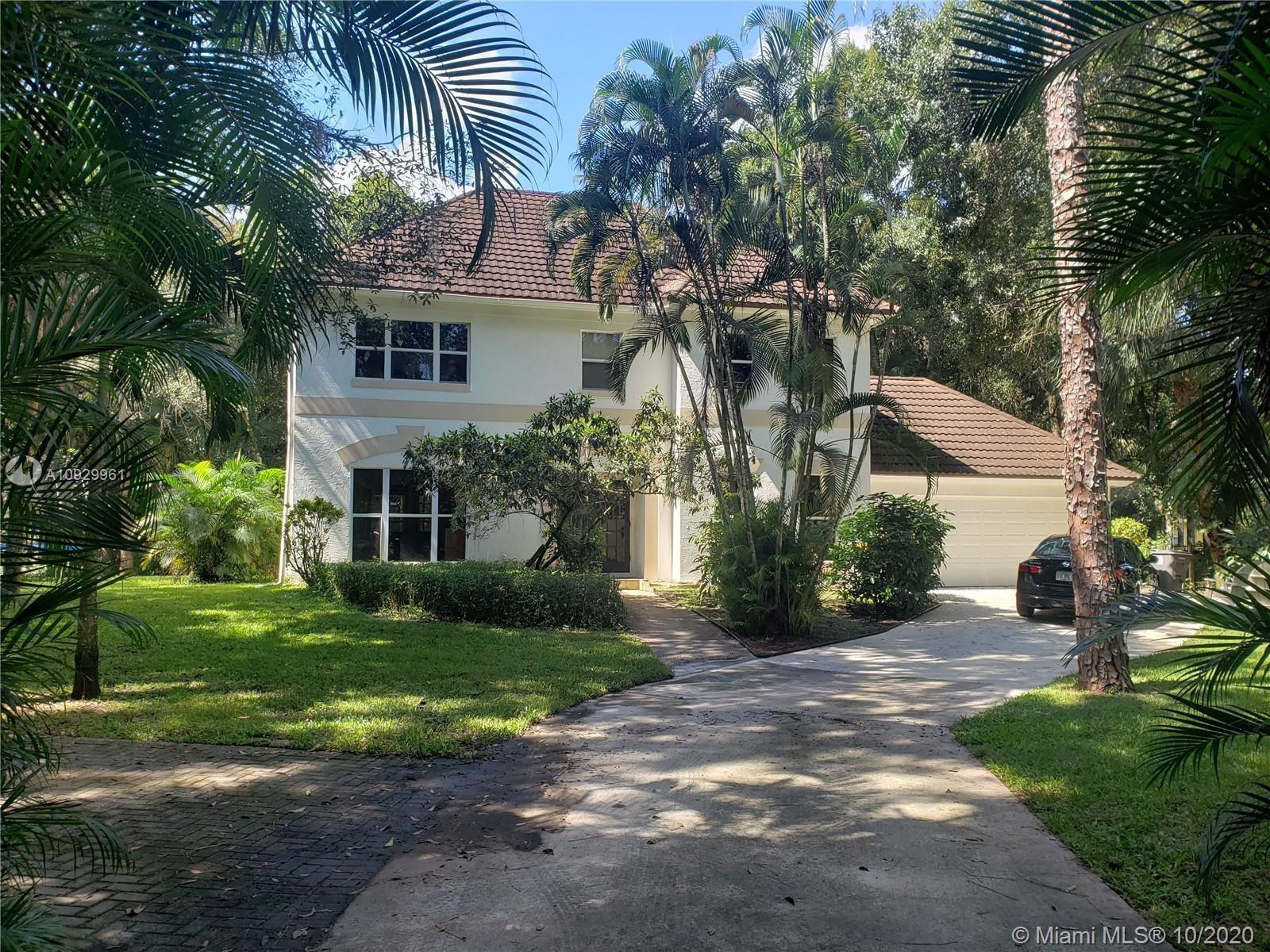 Beautiful 2 story home on 1.45, fenced and gated, acres in Eastern Jupiter Farms.  Just a minute dri
