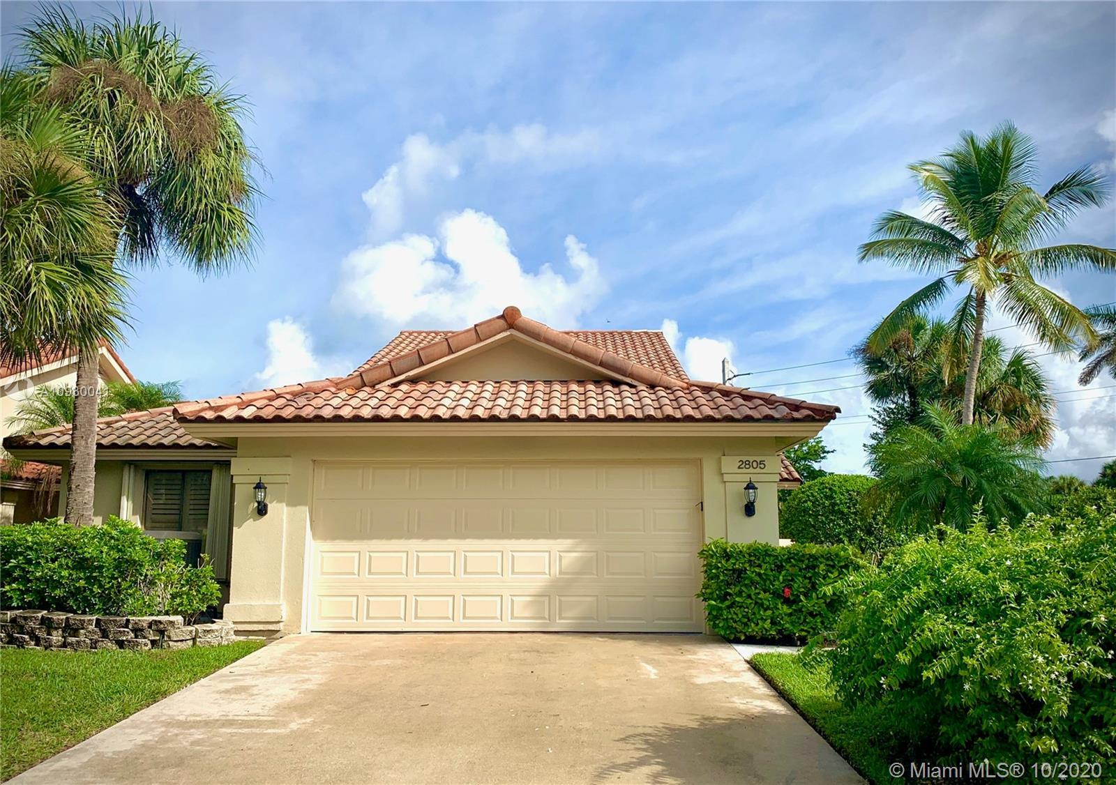 THE SERENITY OF WEST PALM BEACH LIVING AT IT'S FINEST!  THIS SPACIOUS CORNER LOT OFFERS A 3 BEDROOM