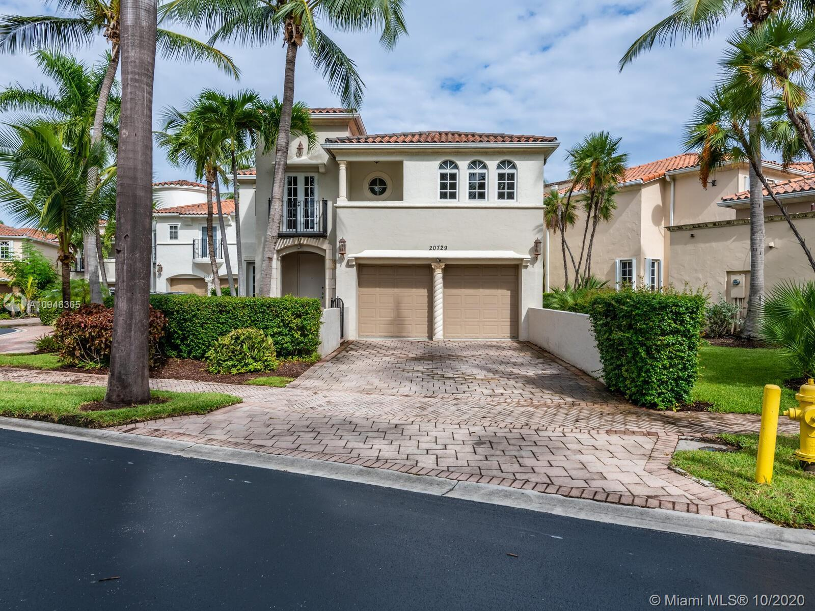 A RARE OPPORTUNITY IN AVENTURA LAKES!!! STUNNING RENOVATED TRUE 4 BEDROOM, 4.5 BATH ON RECORD (3,250