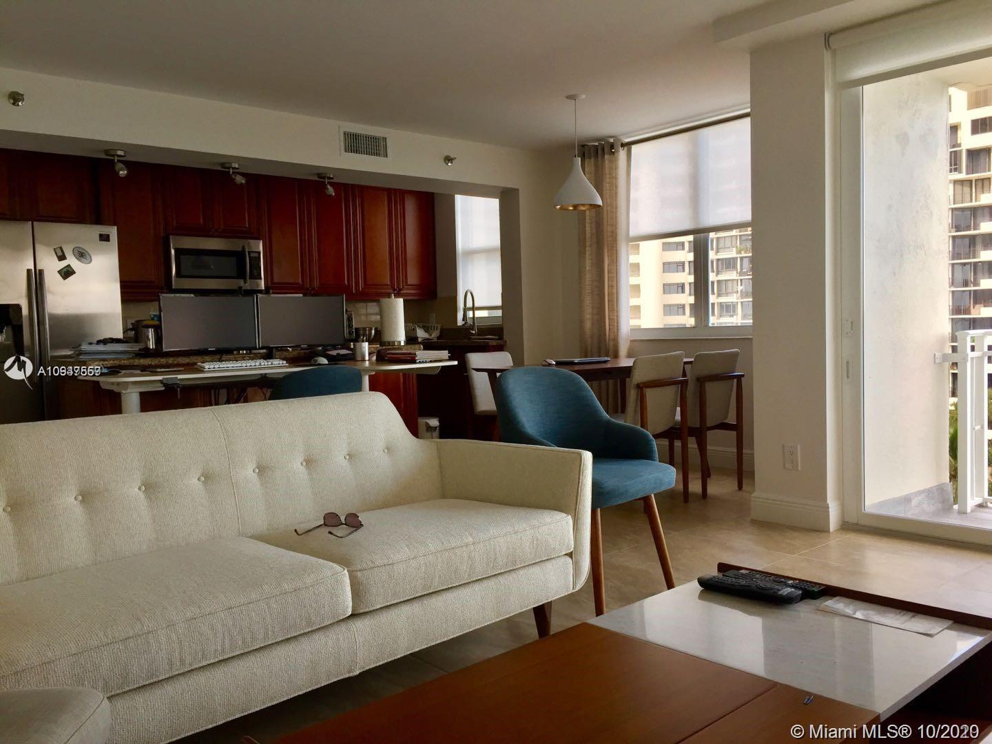 Upgraded Unit with impact windows, wood closet. Waterfront View. Cross the bridge and steps from Bri