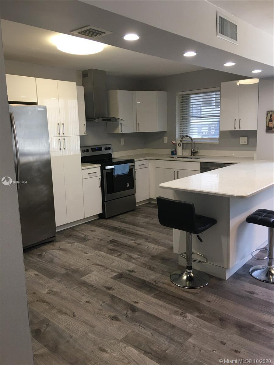 Location, Location, Location! Fully redesigned and renovated preserve gem 1,300 sq. Luxurious 2 bedr