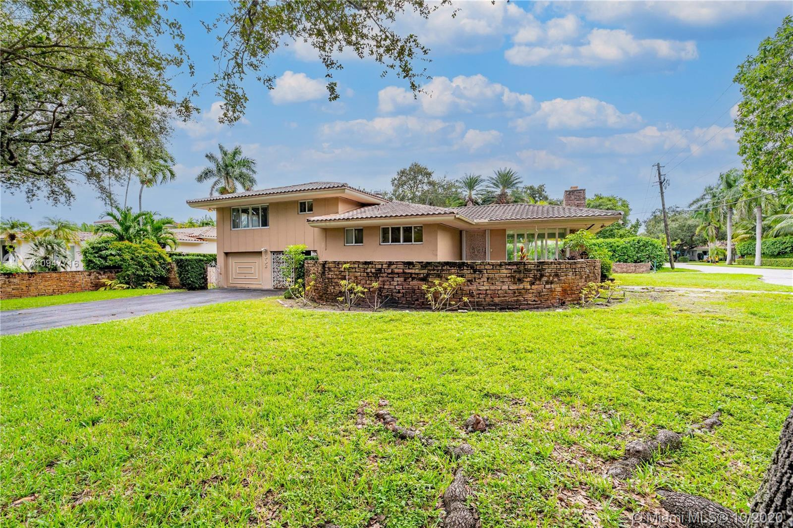 OUTSTANDING VALUE IN THIS MID-CENTURY MIAMI SHORES HOME EAST OF BISCAYNE BLVD.  SPACIOUS AND BRIGHT,