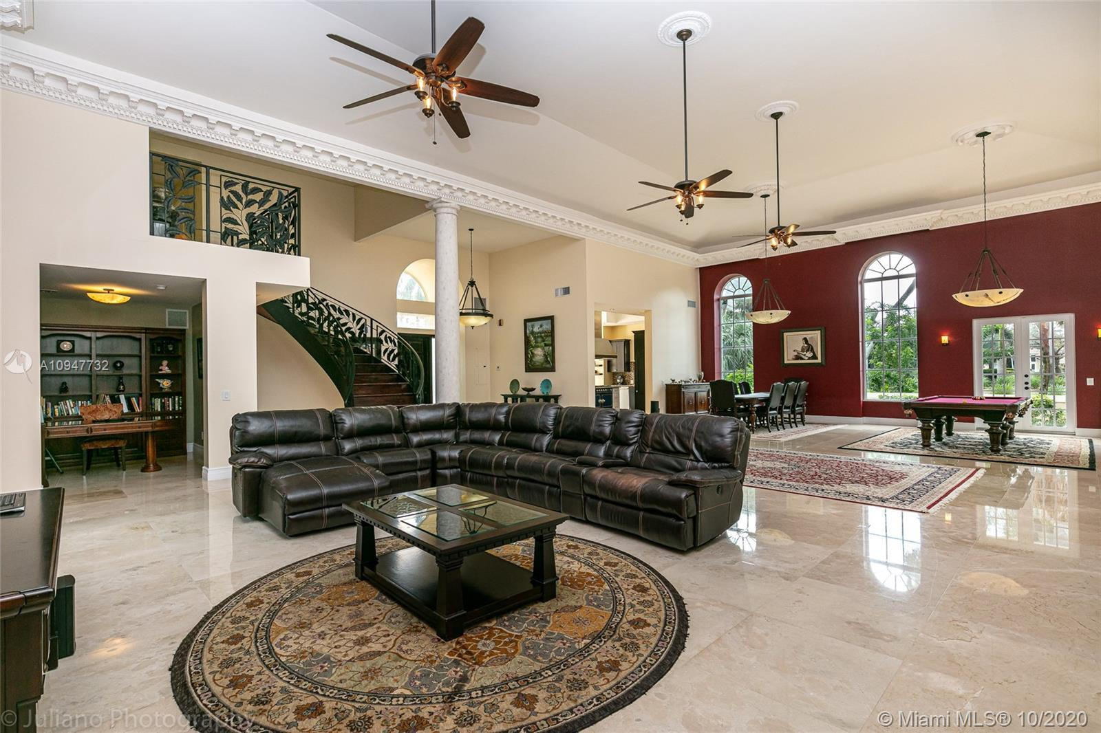 217 Thatch Palm Dr is a one of a kind home boasting an enormous great room along with 5 bedrooms and