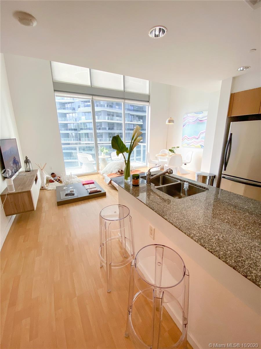 Located in the heart of Brickell, this impeccable 2 story loft style boasts breathtaking city and pa