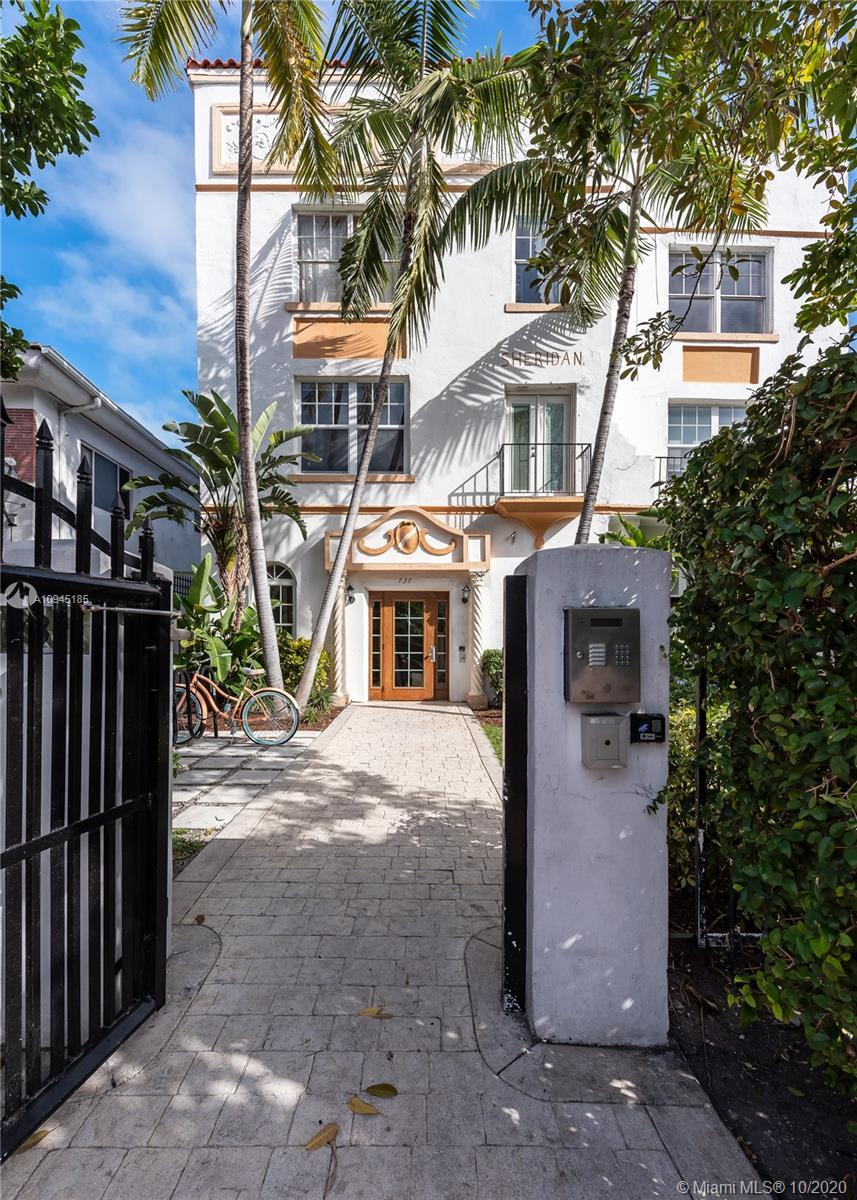 1925 Mediterranean building uniting urban life with your private refuge. Situated on a quiet street,