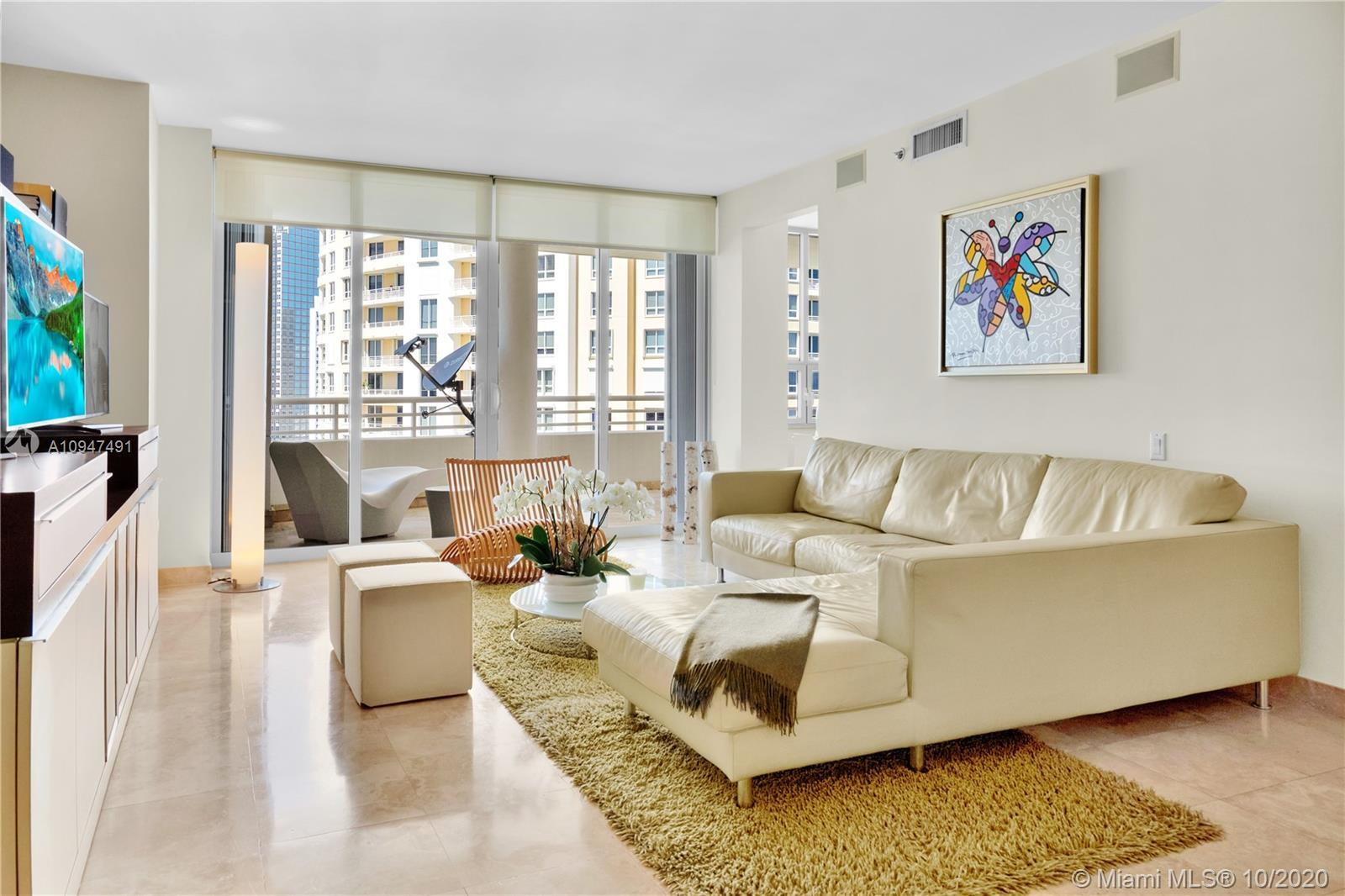 Live in the elegant Two Tequesta Point on Brickell Key - This rare high floor unit has stunning city