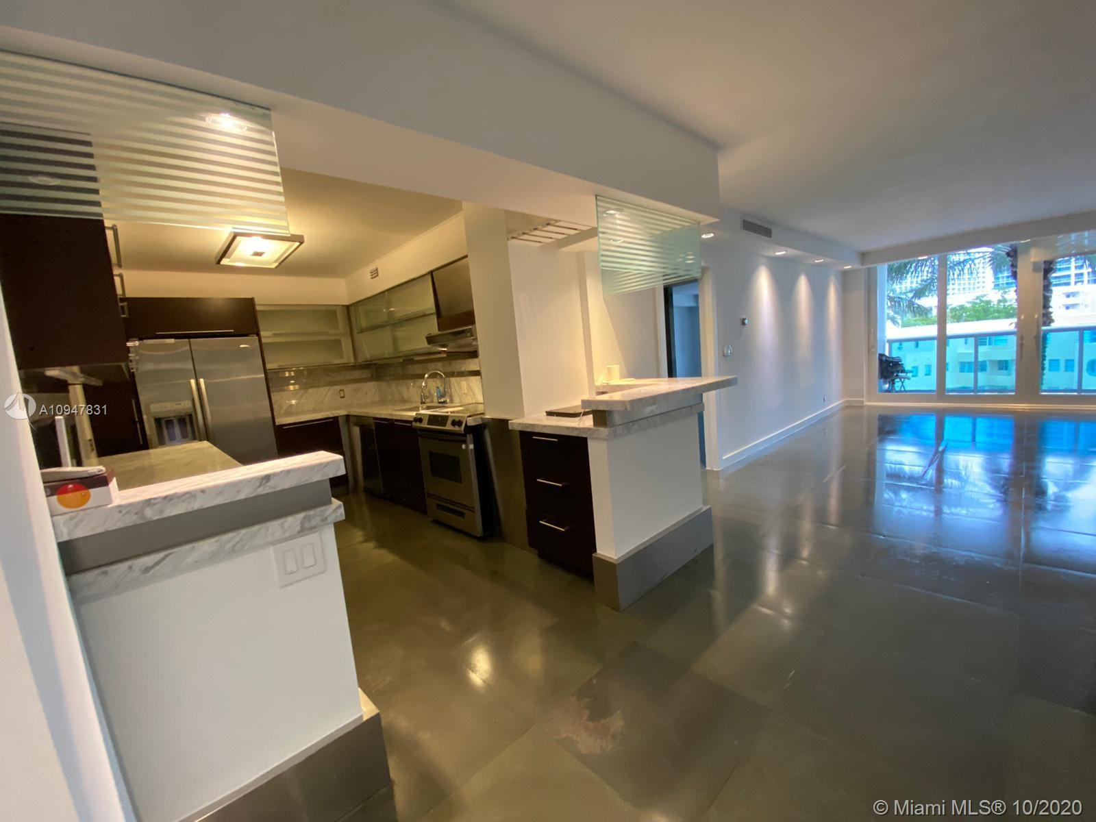 UNIQUE, SPACIOUS & RENOVATED 3/2 CONDO IN AQUASOL, NICELY CONVERTED TO 3 BEDROOMS & TWO FULL BATHS.