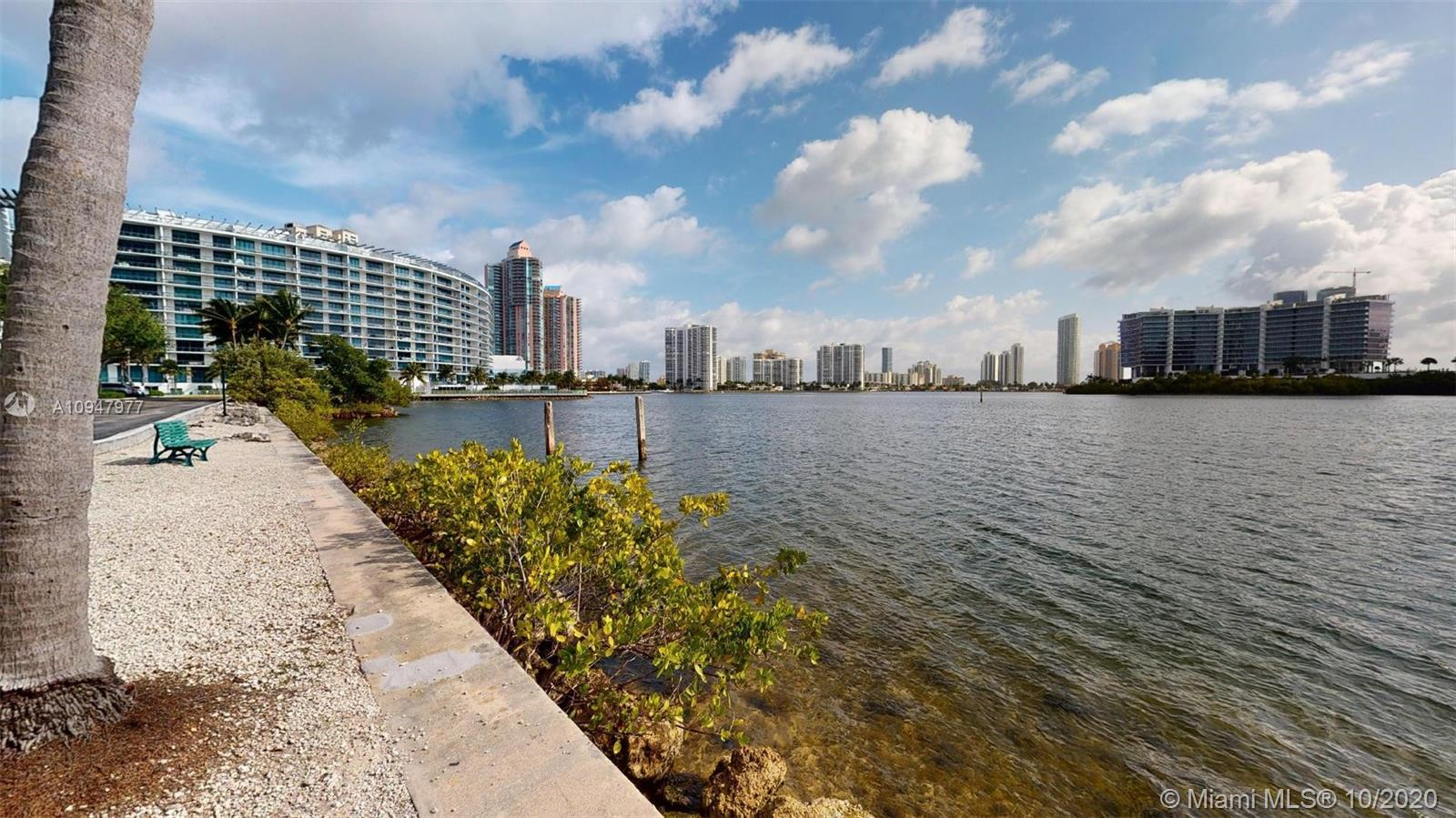 Amazing Water Views from this 3 Bedrooms 2 Baths + Den Corner unit in the heart of Aventura. Enjoy t