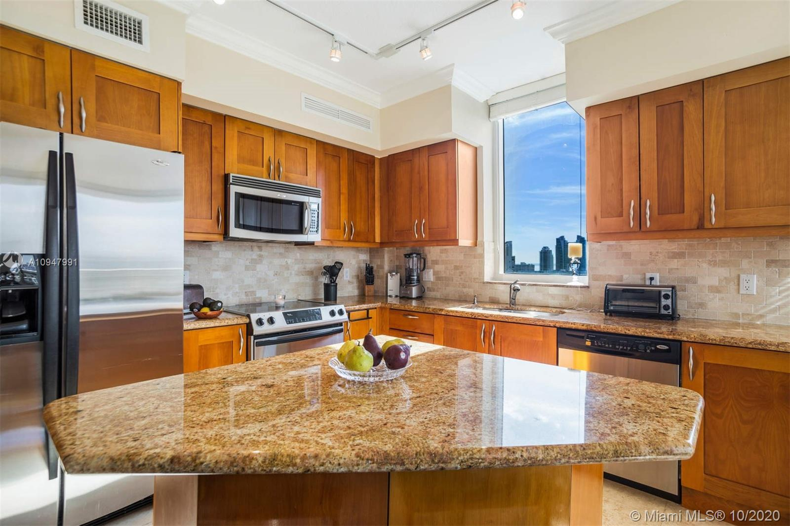 Welcome to your new home! This incredible corner unit features amazing unobstructed views to the Sou