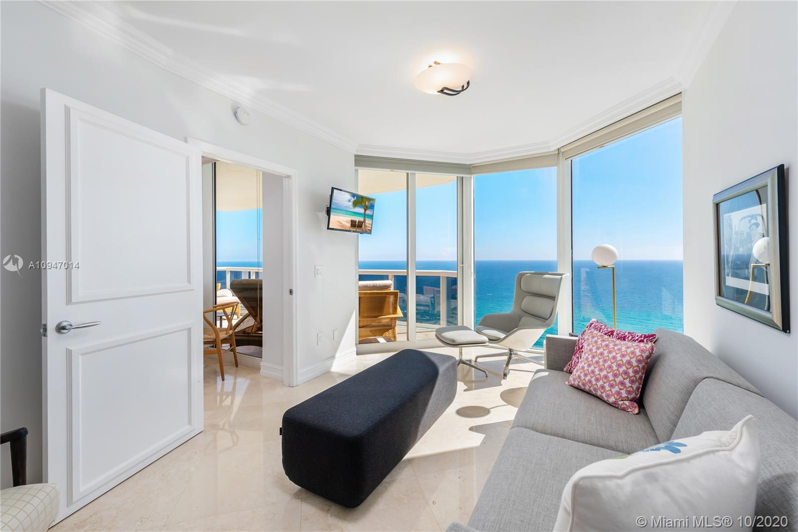 Enter through a double door & you are immediately greeted with stunning direct ocean views from this