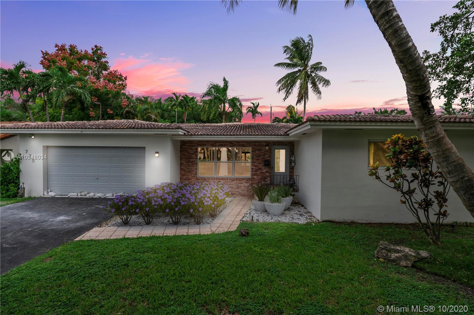 Spacious & openness defines this mid-century Miami Shores home. Enter into a big living room that ov
