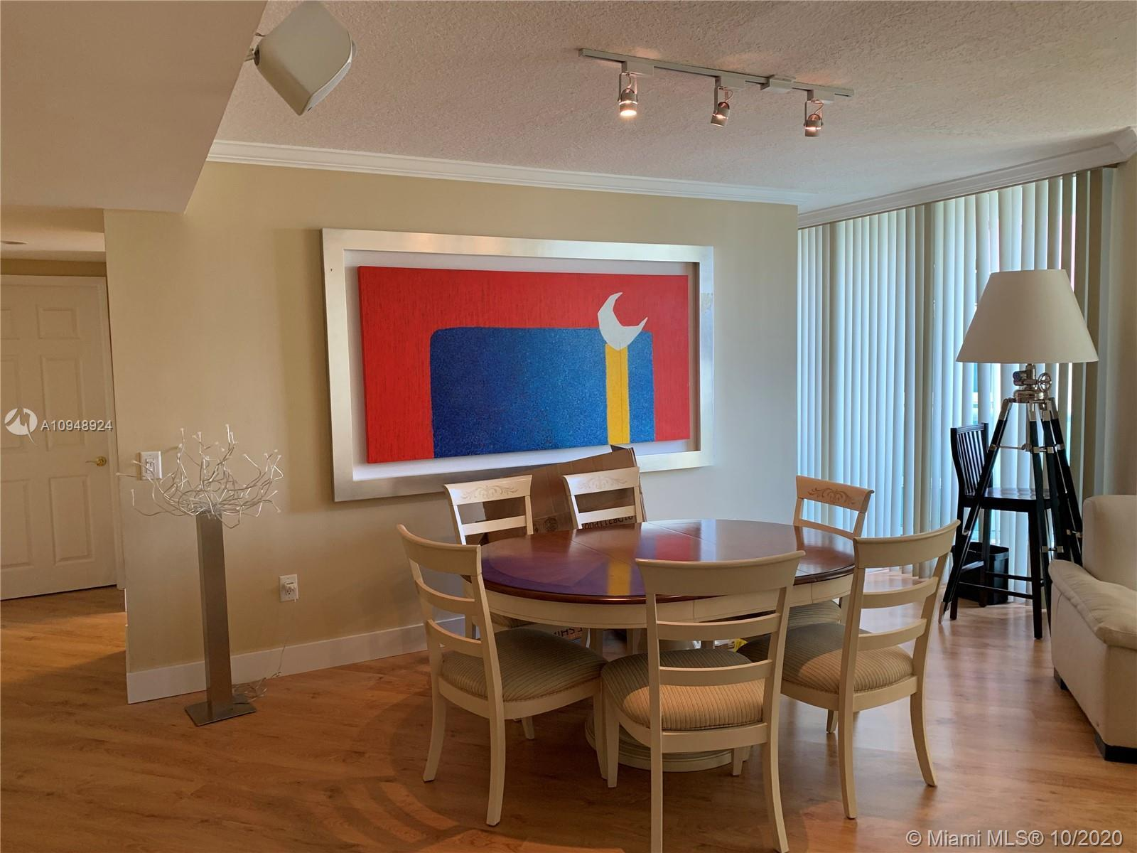 Wonderful 2 bedrooms, 2.5 bath apartment with a view of tennis courts and bay area.  New floors, kit
