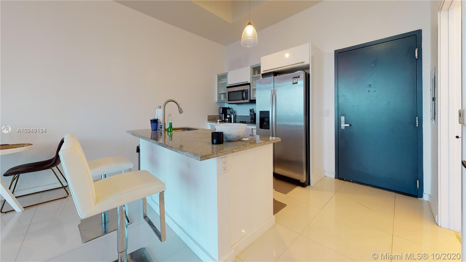 GORGEOUS 1 bedroom, 1.5 bath unit with floor to ceiling windows. Breathtaking water and city views f