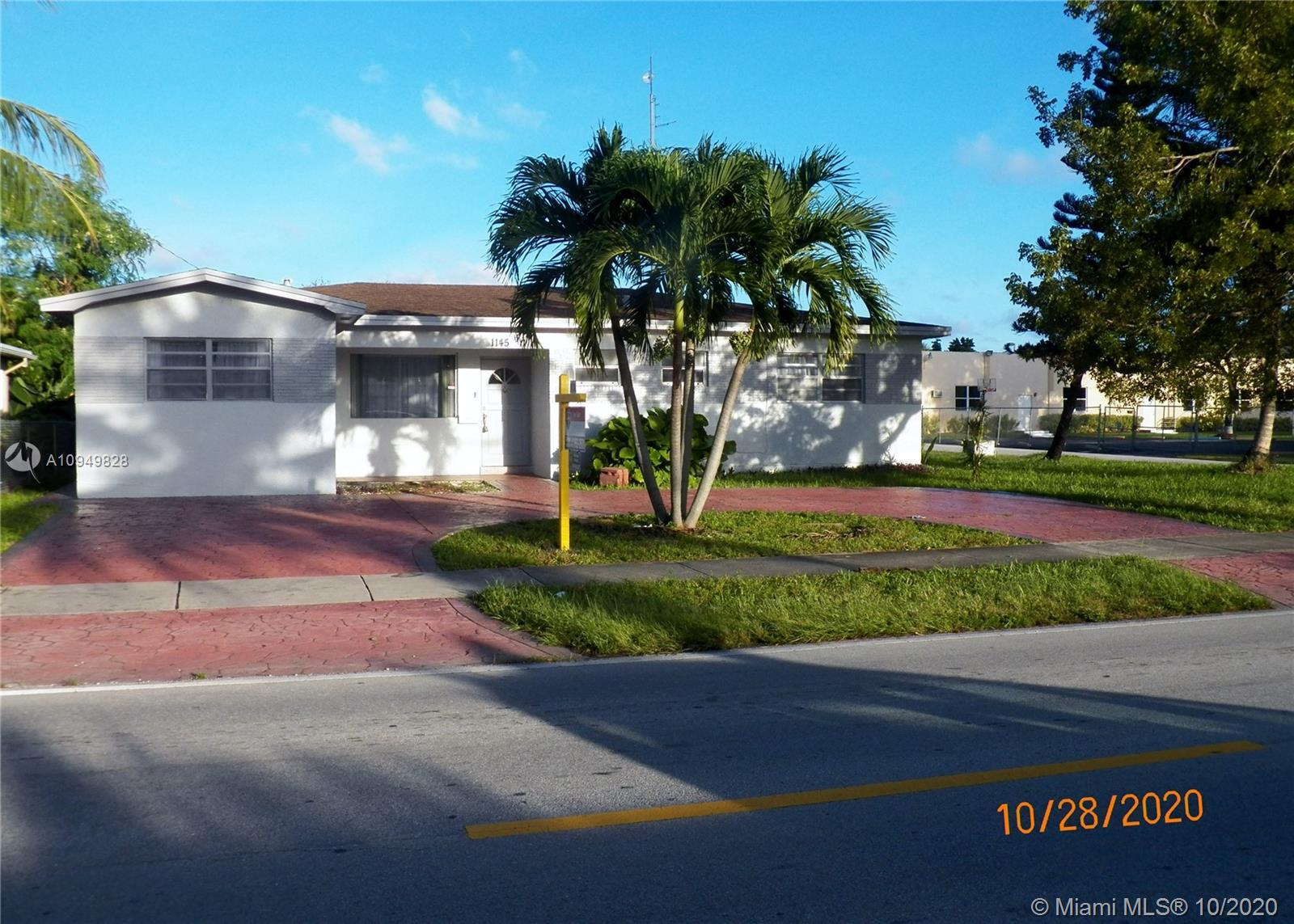 REDUCED $20000! UPDATED AND SPACIOUS 4/2 - NEW KITCHEN CABINETS, NEW STAINLESS STEEL APPLIANCES, GRA