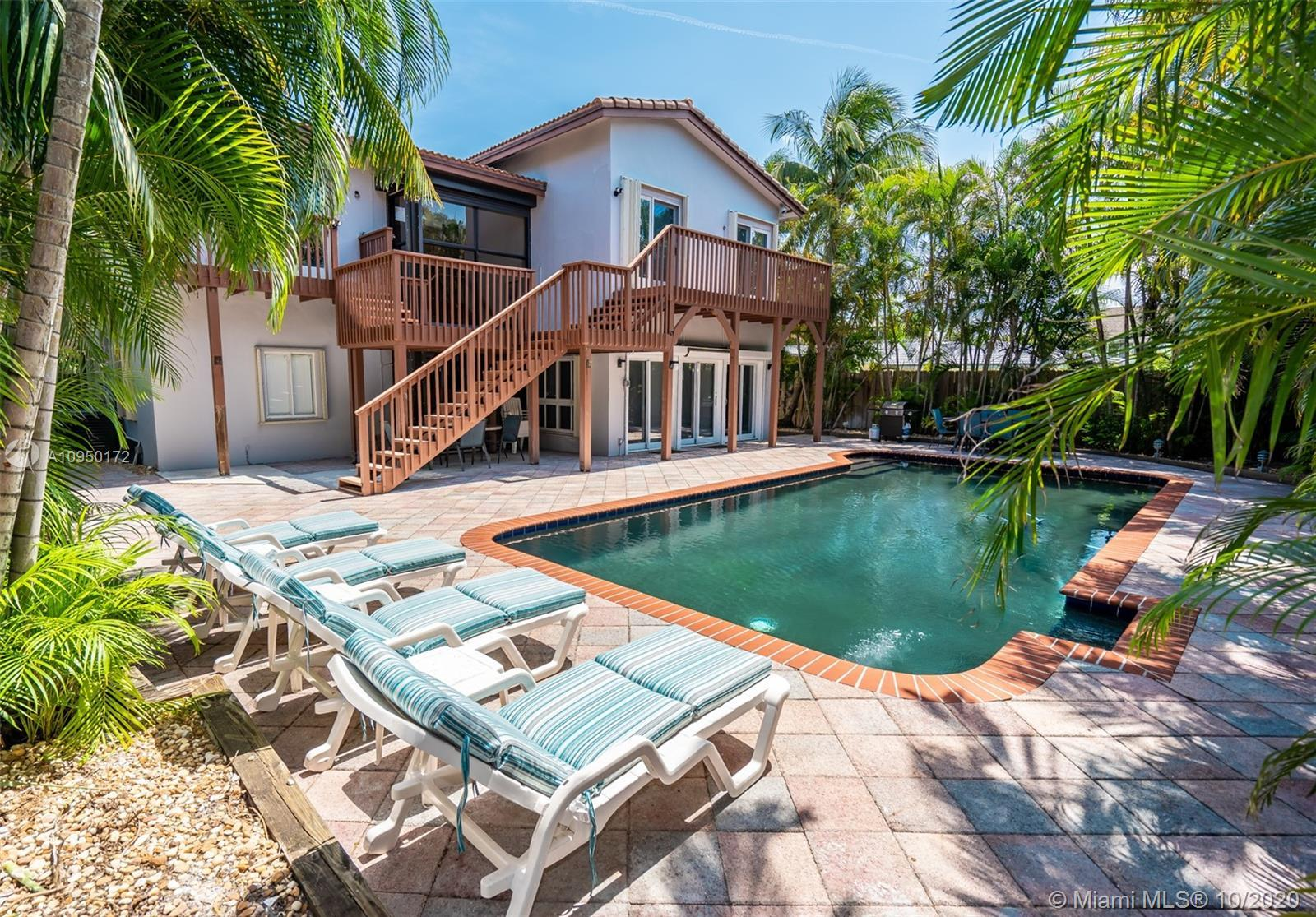 STUNNING 2 STORY HOME, 4 BEDROOM, 3 FULL BATH PLUS DEN OR OFFICE. WALK TO THE BEACH AND TOWN WITH A