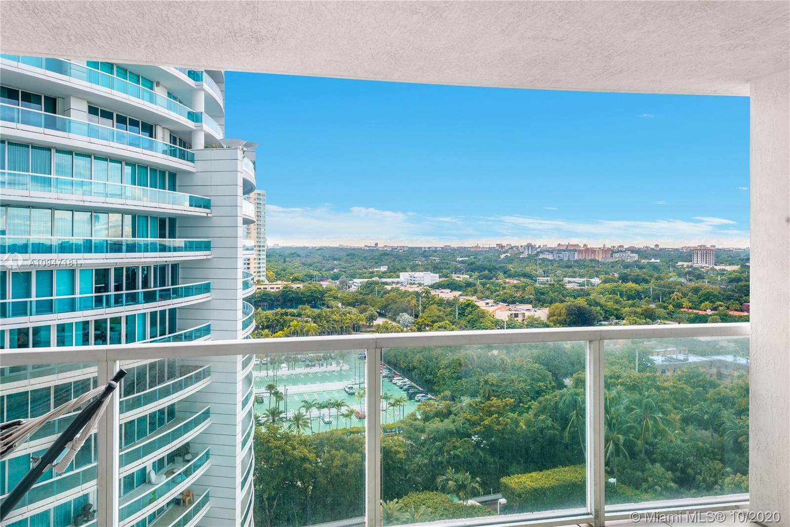Incredible water and city views from this 1 bedroom, 1 bath unit at the Skyline on Brickell.   Very