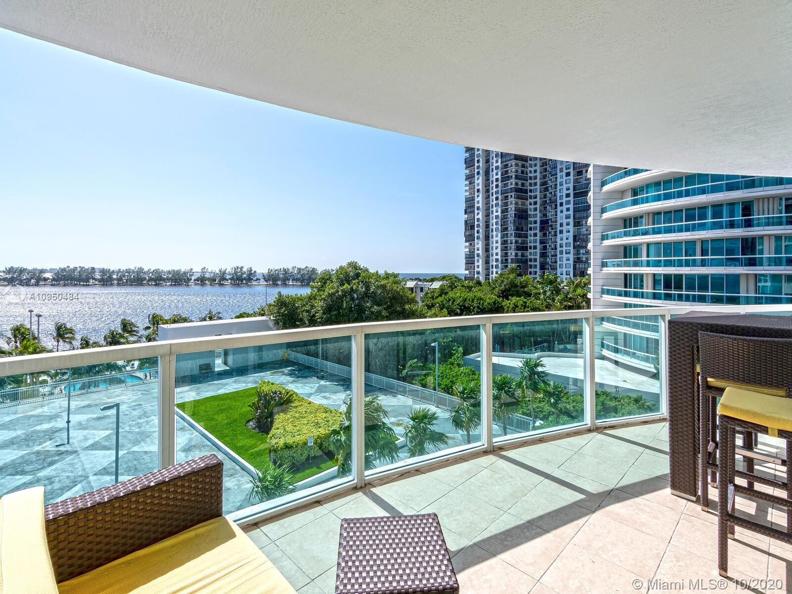 Great bayfront corner unit with floor to ceiling windows, featuring italian kitchen with granite cou