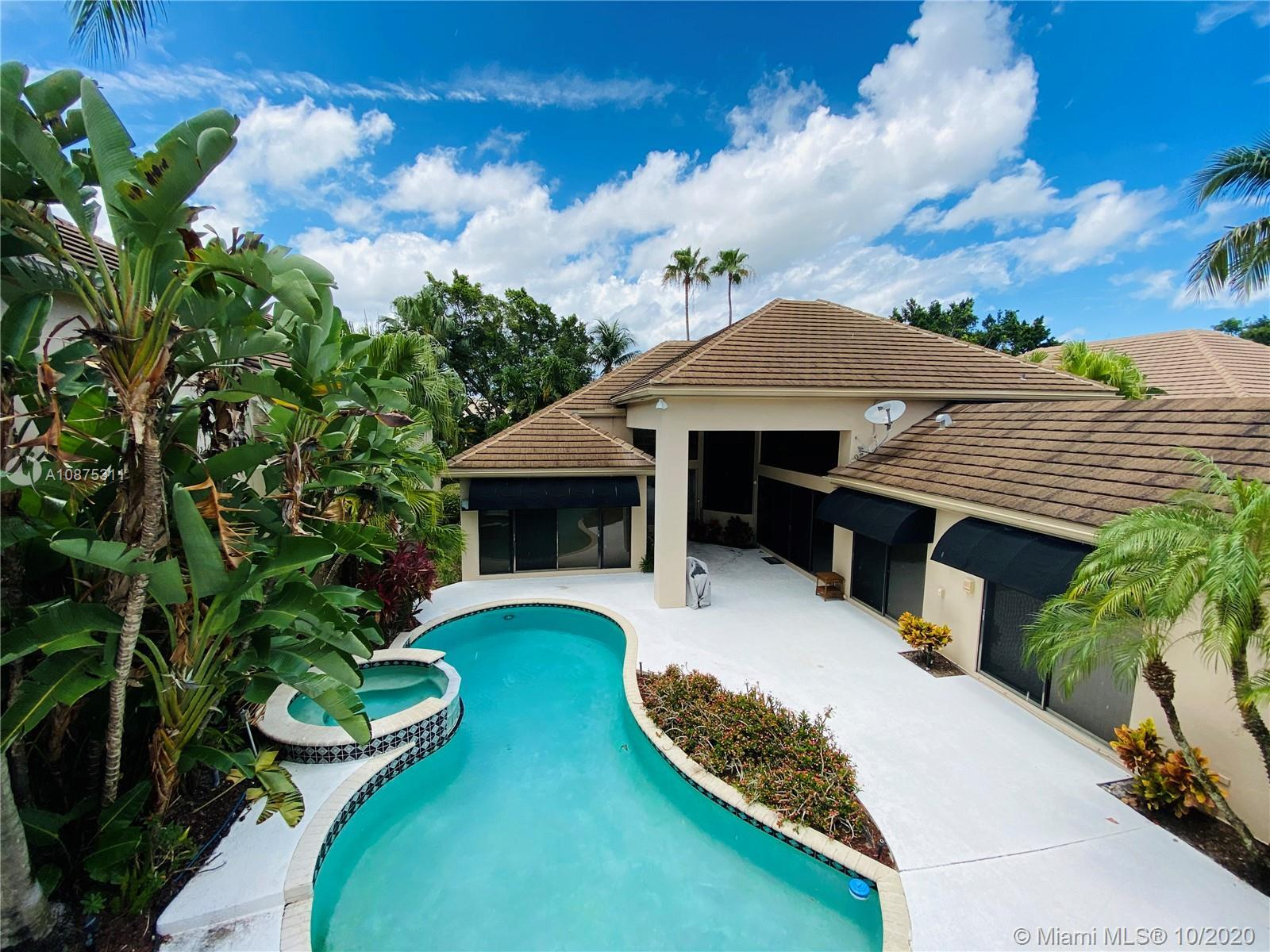 $60K price reduction. Priced for Sale. Broken Sound Country Club. Courtyard home with 2 guest suites