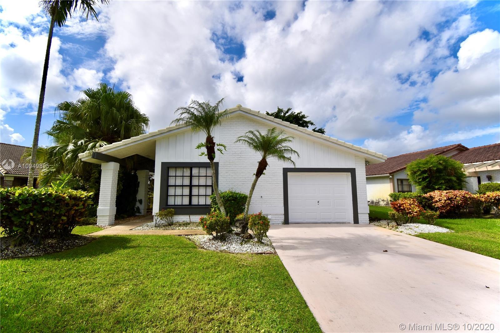 Make this beautiful one story property in Boca Greens your home. Great floor plan with an open livin