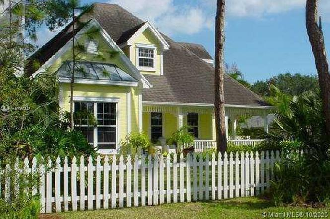 Tropical paradise in coveted Jupiter neighborhood by the river! Vaulted ceilings, wood burning firep
