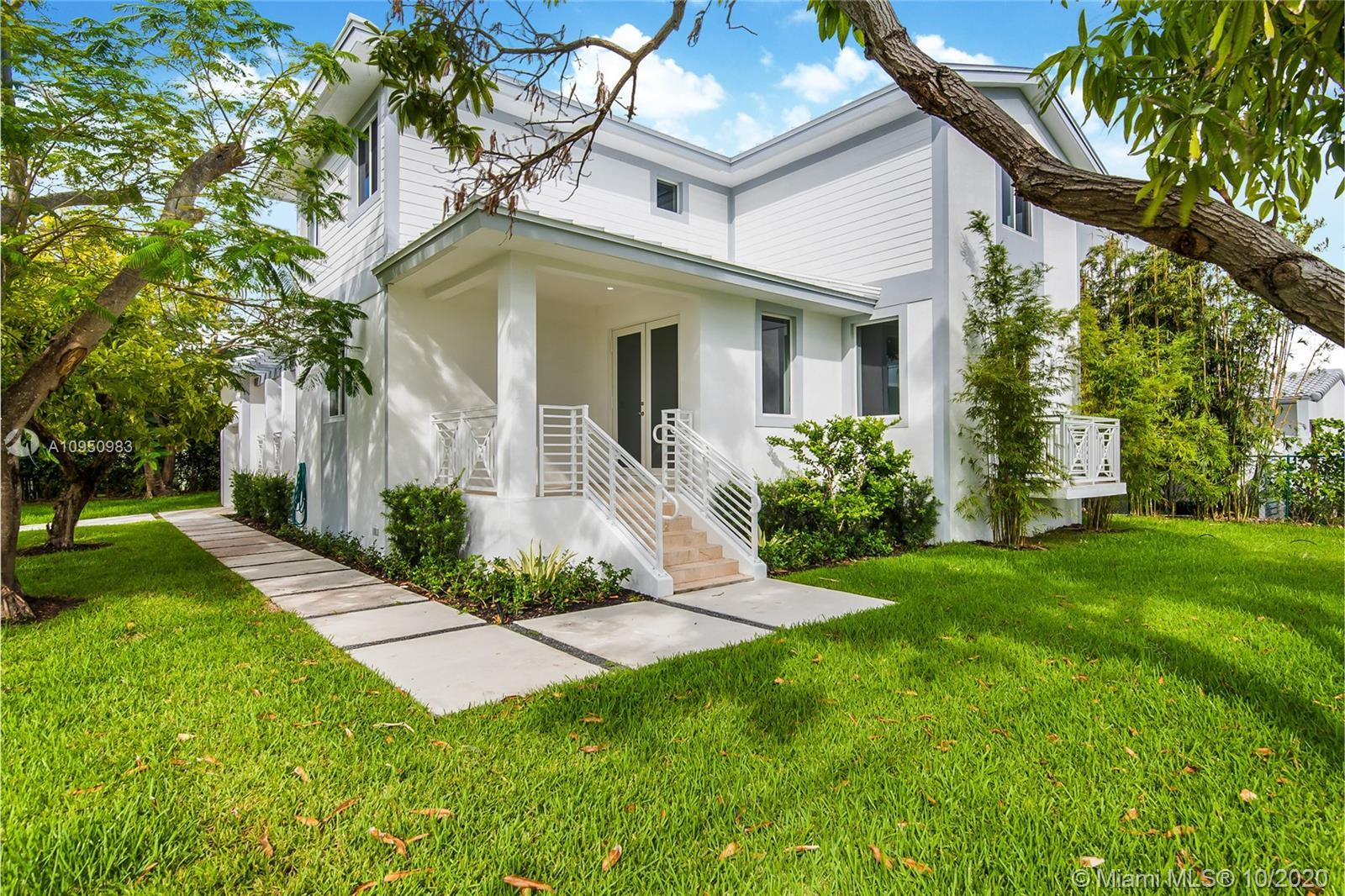 NEW CONSTRUCTION IN SURFSIDE on a large corner lot! New two-story home with 4 large bedrooms, 3 bath