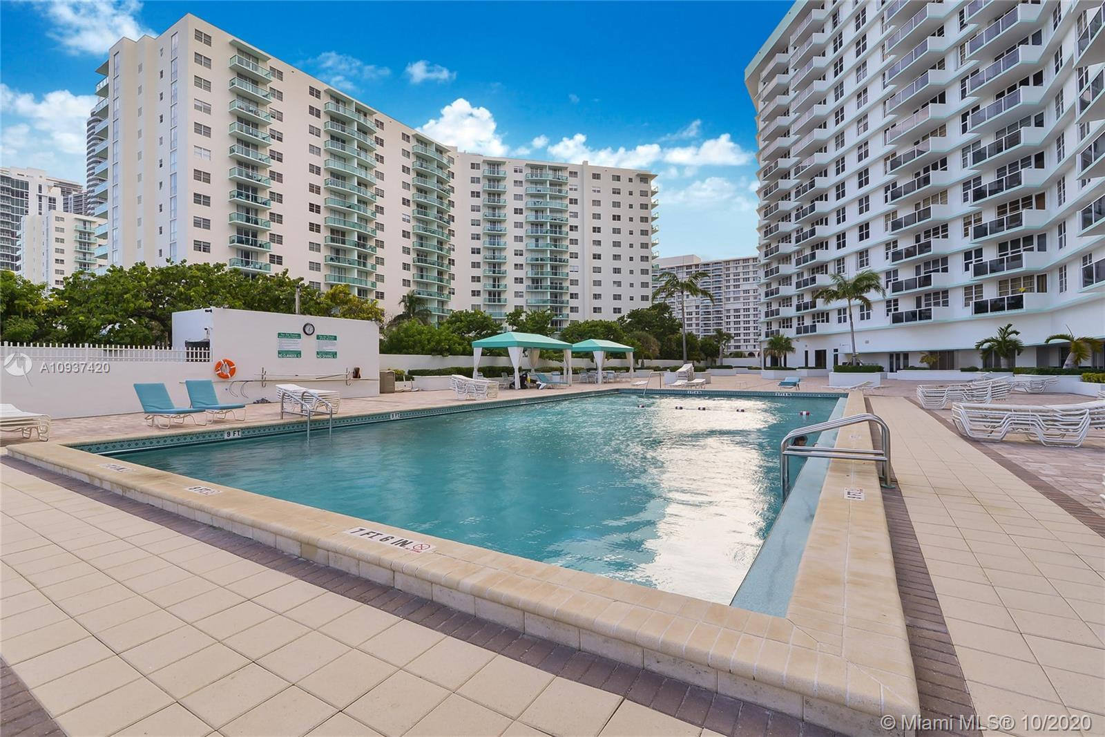 GORGEOUS CONDO TASTEFULLY REMODELED , WHITE KITCHEN CABINETS WITH STAINLESS STEEL APPLIANCES, BEUTIF