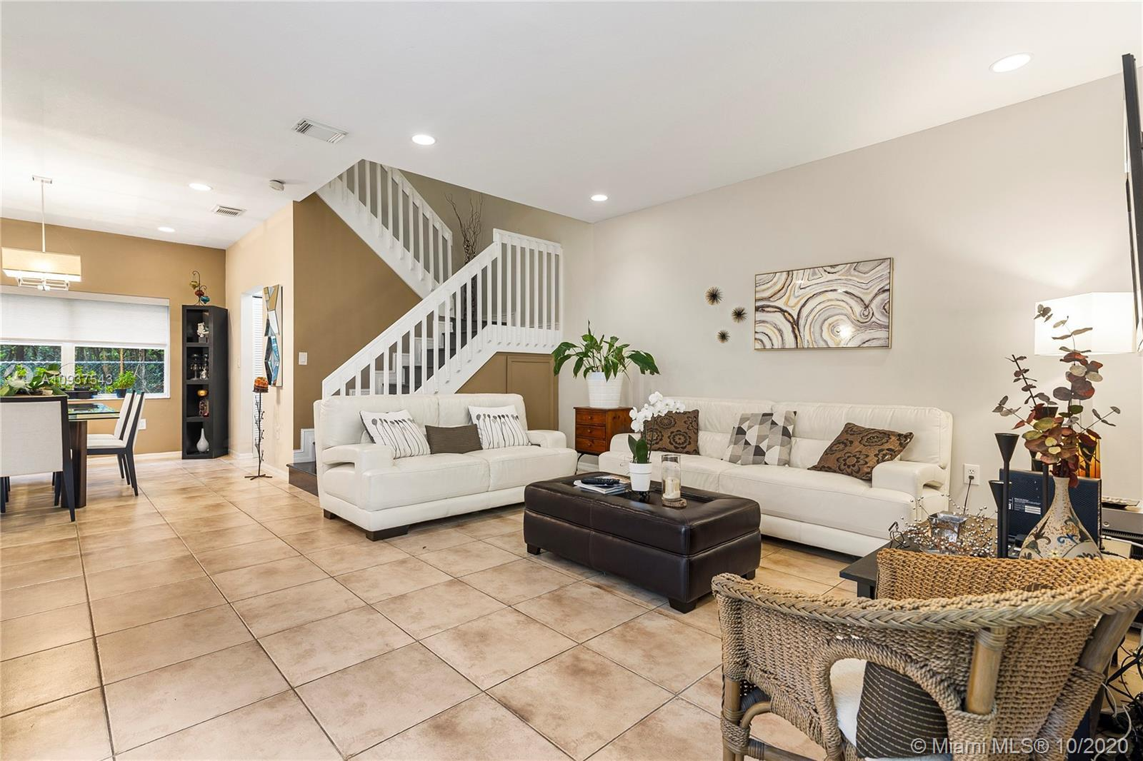 LOCATION! One of the few Townhome units that faces the lake and backs to the preserve, allowing wind