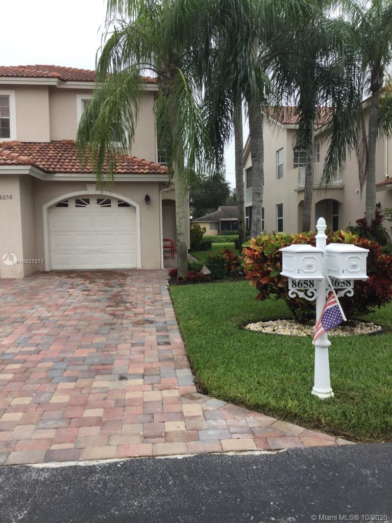 Beautiful, spacious Corner unit, located at Villa San Remo, 3 bedroom, 2 bath, new Pavers on drive w