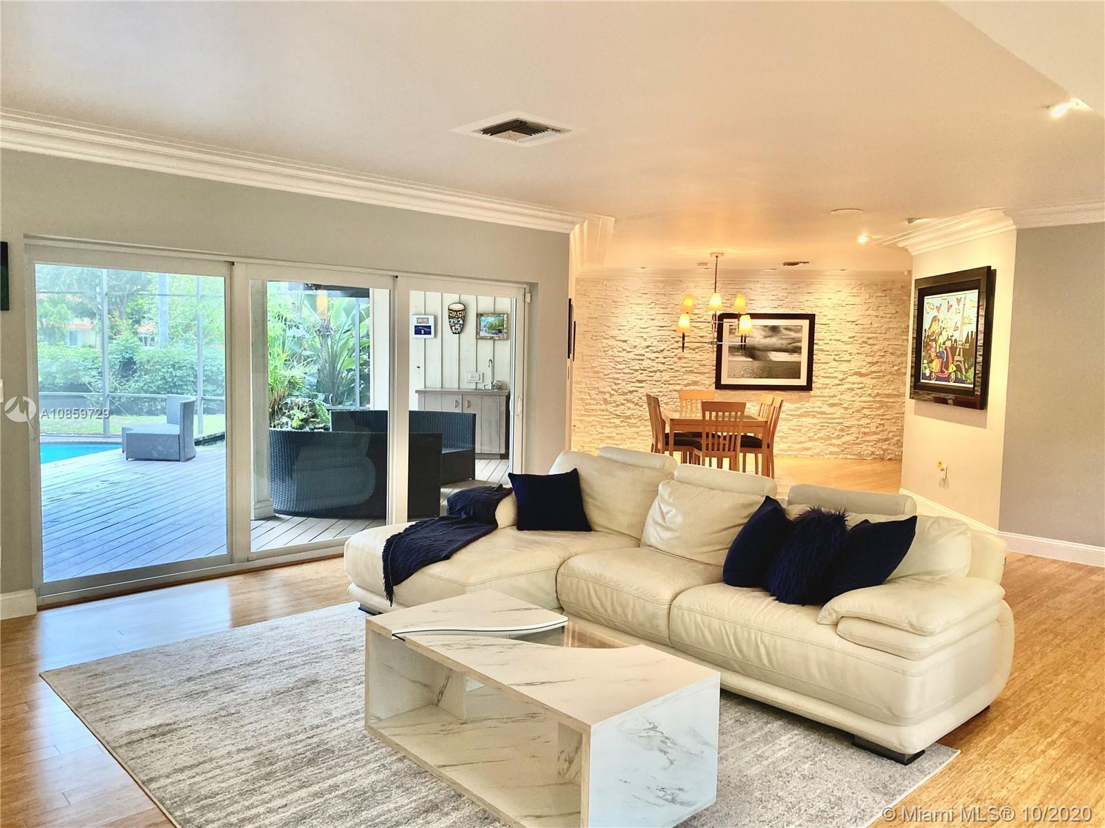 Escape to this Miami Shores Oasis.  This Gorgeous Home features an Open Floor Plan with 4 large Bedr