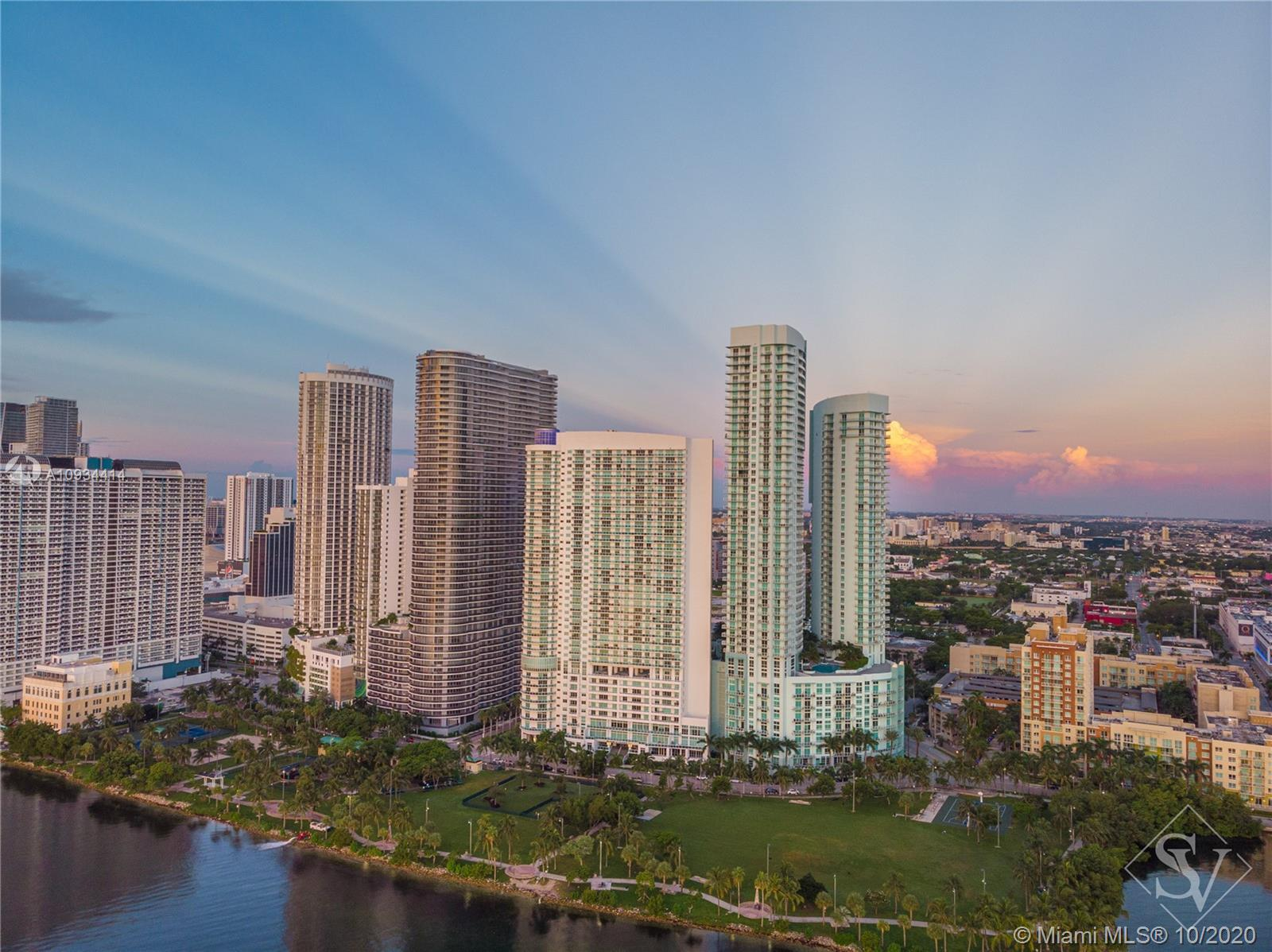 Live in one of Miamis most desirable neighborhoods steps from shopping dining & entertainment in thi