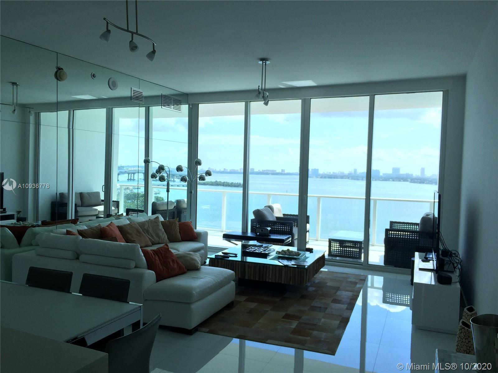 STUNNING BAY VIEWS FROM THIS 3 BED 2.5 BATH+DEN AT THE UNIQUE & RENOWNED PARAMOUNT BAY. WITH OVER 1,