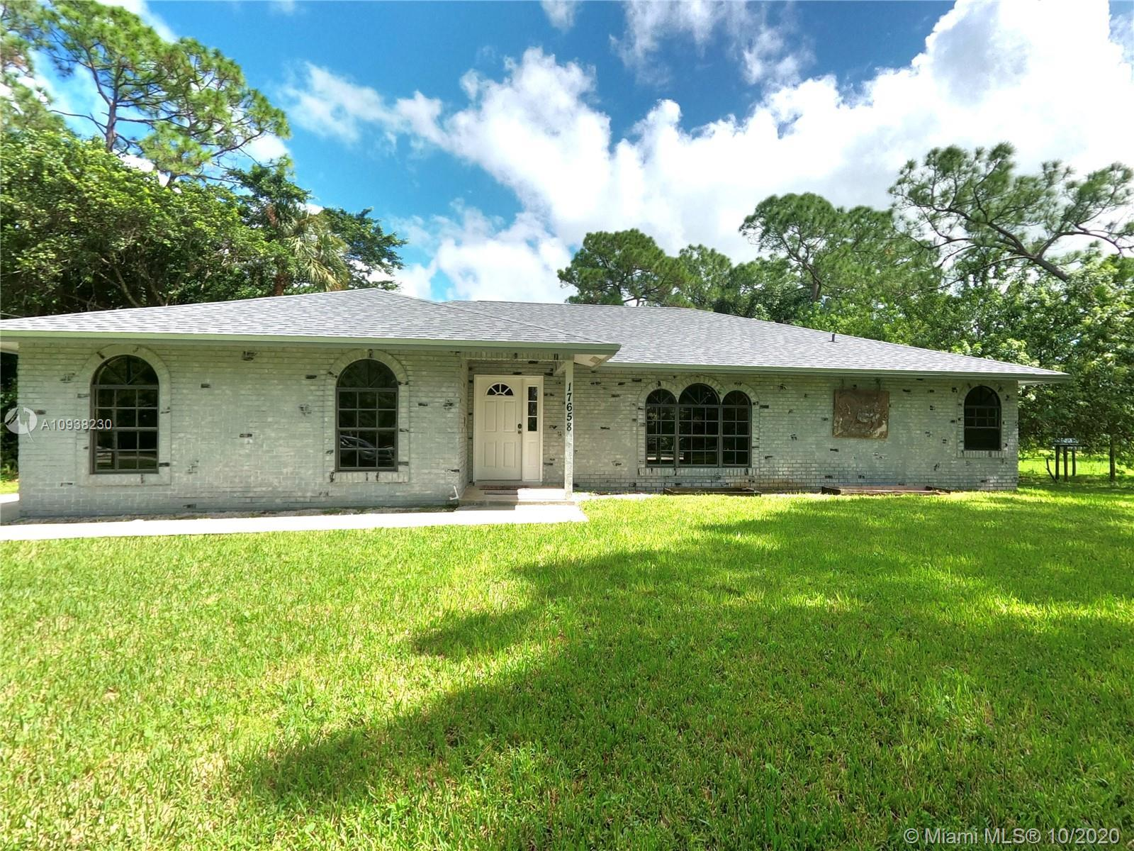 Jupiter Farms home with pool! Your family will enjoy the comfort of this 3 bedroom, 2 bath home.  Wo