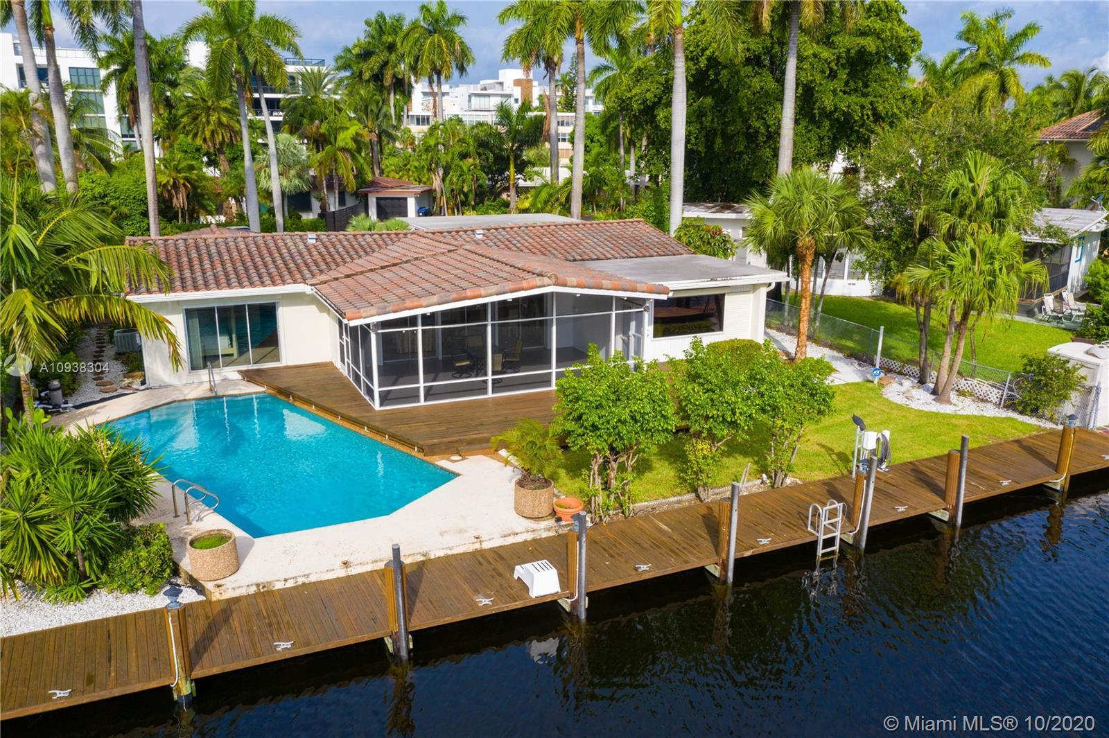 Welcome to your South Florida Oasis! Located on the iconic Fiesta Way on the Las Olas Isles, this cl