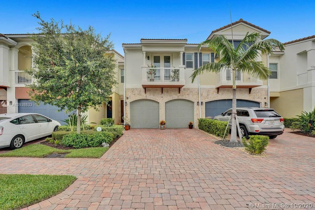 This 3 bedroom 2.5 Plus loft with a 2 car garage newly built townhouse is located In East Boca , clo