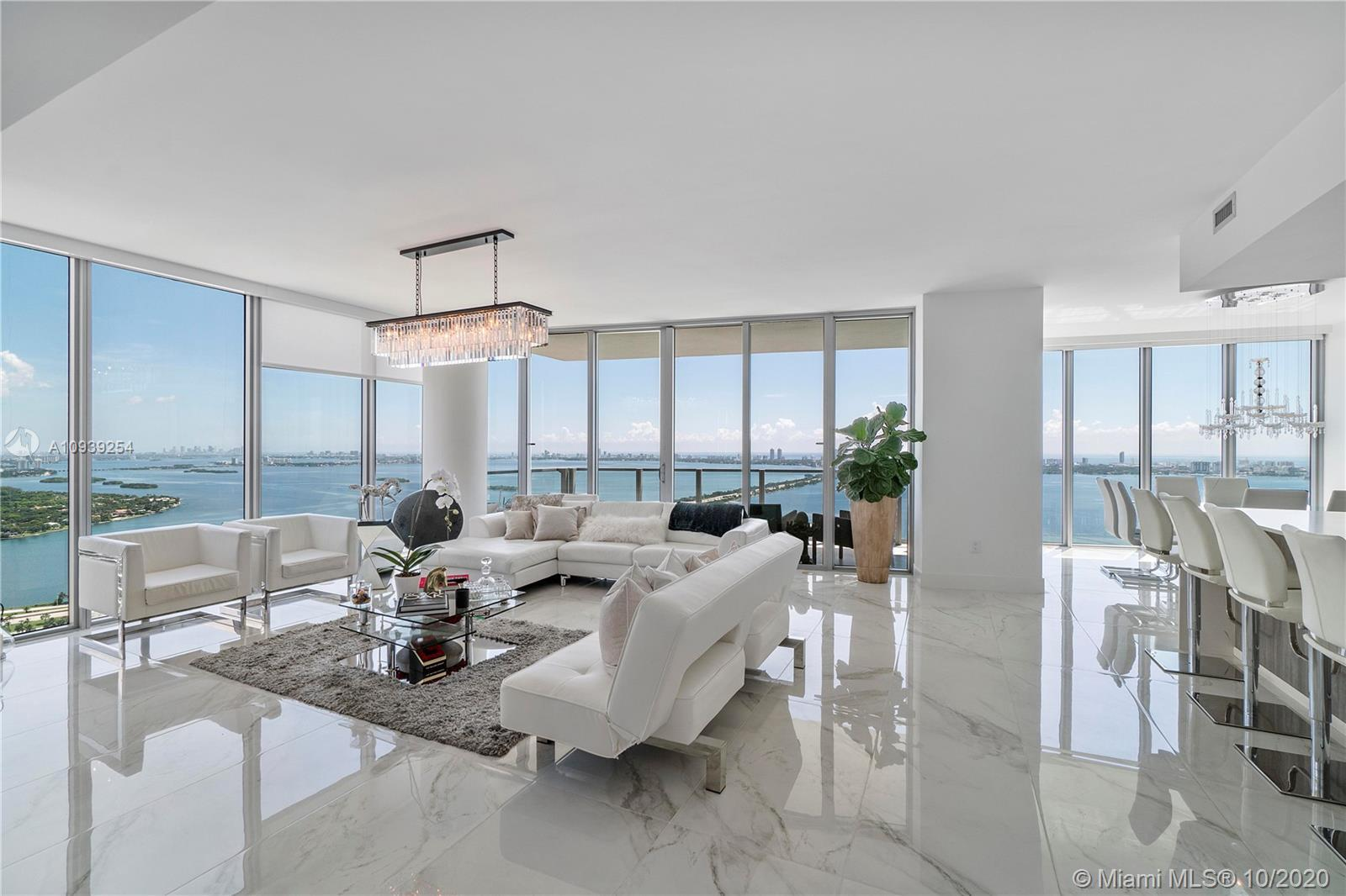 Very unique completely furnished 4 bed/5 full bath plus den corner unit with 3,191 sq. ft of living