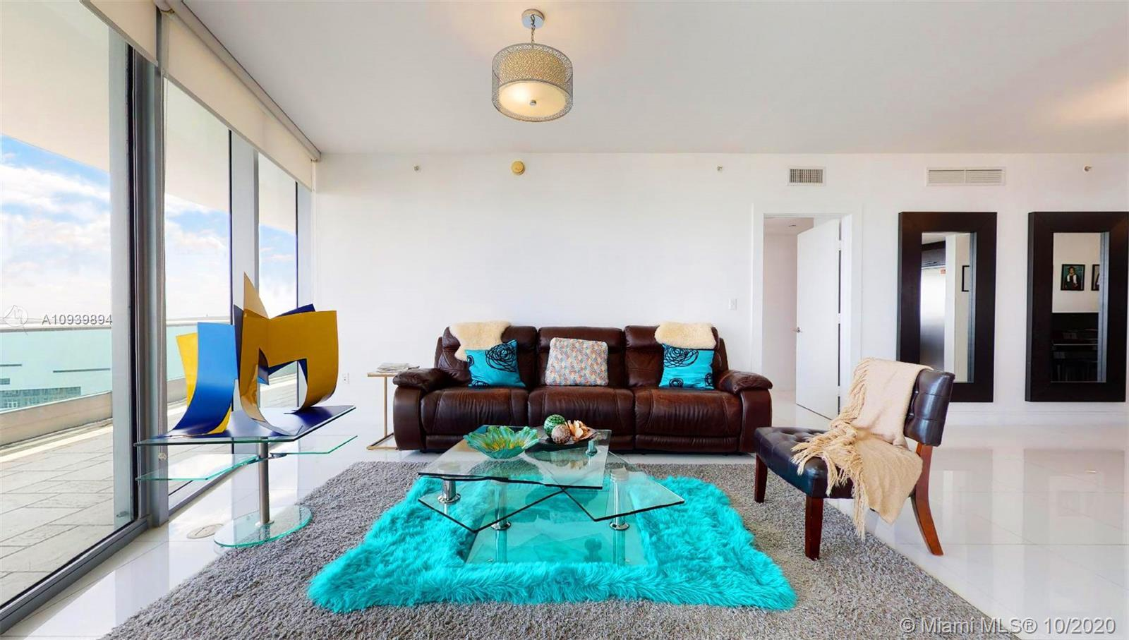 Wake up to stunning direct water views of Biscayne Bay. This Luxury Condo 3 Bed + Den, 4 Bath in the