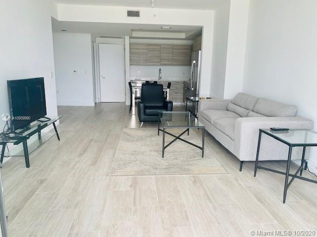 Furnished 1 bed + den, facing west. High end finishes & GE appliances, porcelain wood floors. State