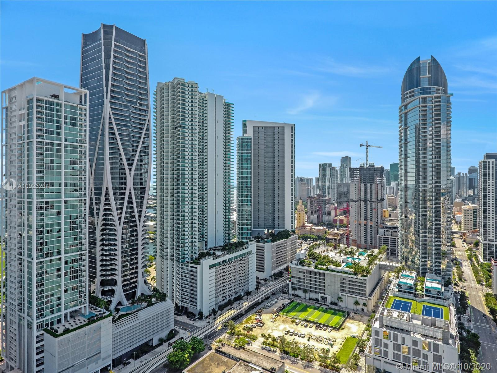 Beautiful corner unit with a wraparound balcony. Features an amazing and unobstructed view of the ba