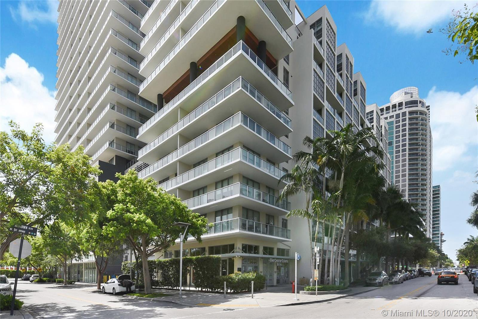 Tastefully renovated 2BD/2BA corner unit offers an open floor plan, 12' exposed concrete ceilings, S