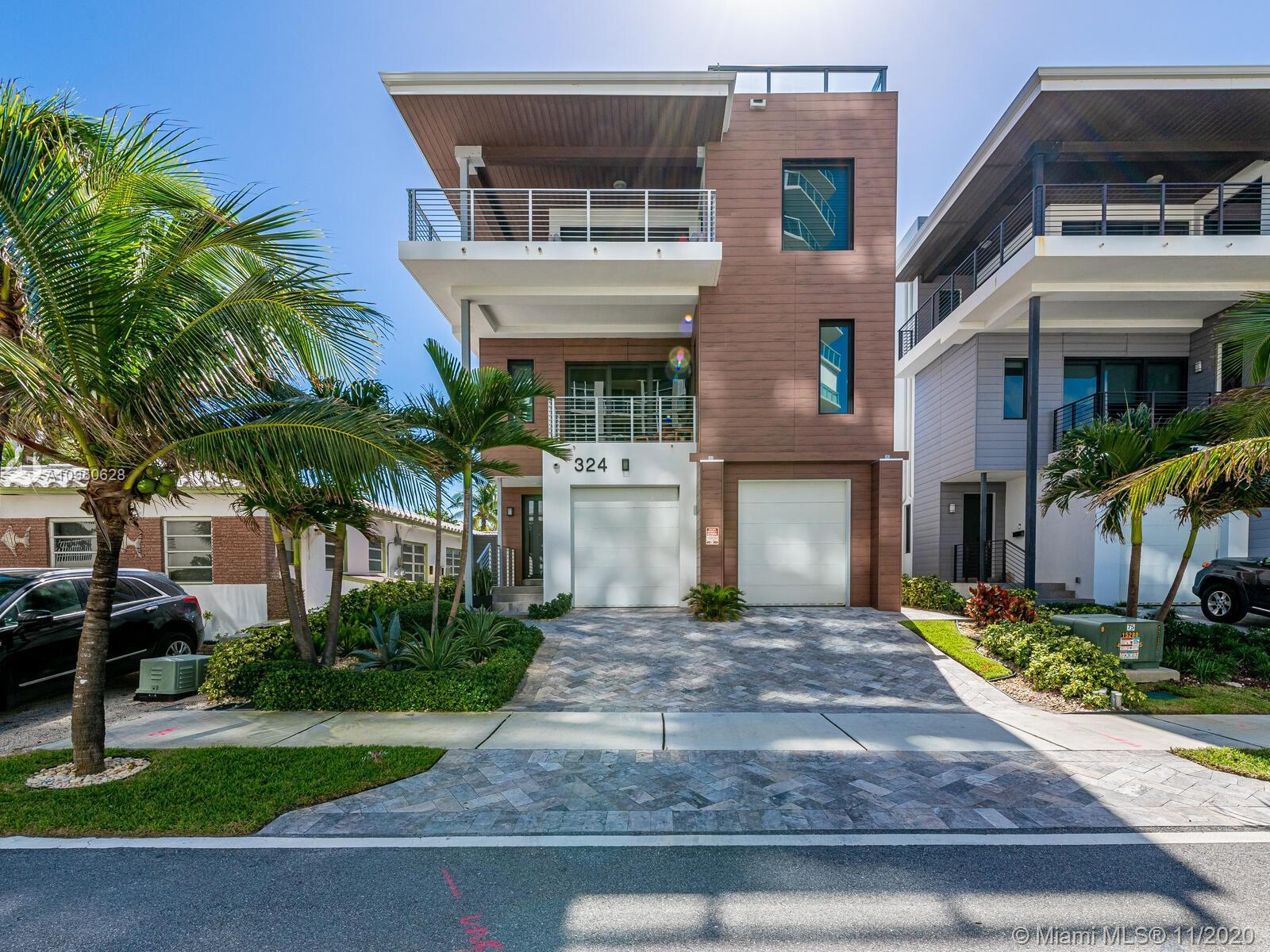 Stunning contemporary 4 Bed 3.5 Bath Tri-Level Beach home with direct ocean views. This 3,000+ sf ho