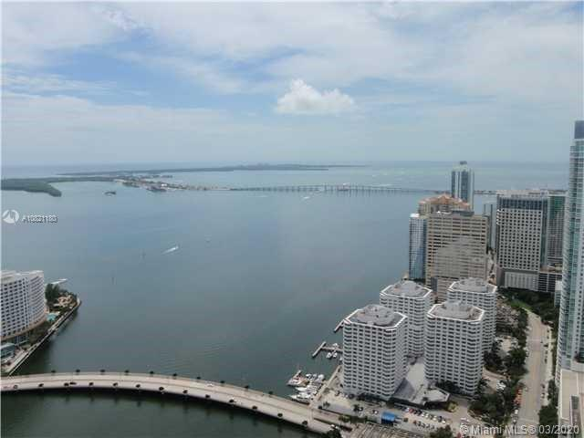 Amazing unobstructed views to Biscayne Bay! This 984 sq ft spacious modern condo, located in the hea
